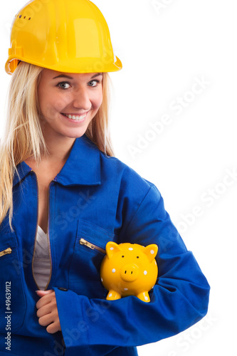 Female engineer with piggy bank