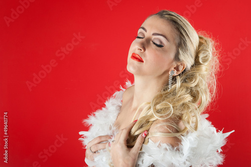 Beautiful blonde woman close up portrait with white ostrich
