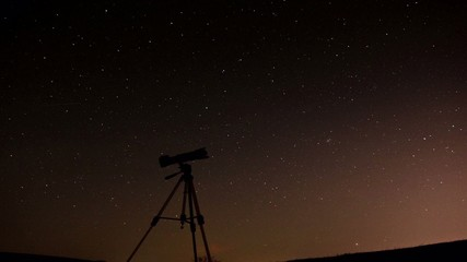 Movement of stars with telescope in foreground