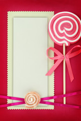 Blank banner with lollipop on pink background
