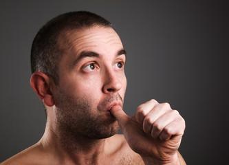 Man sucking his thumb