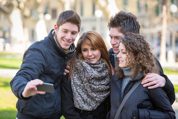 Group of Friends taking Self Portraits with Mobile Phone