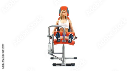 Slender blonde doing exercises on trainer