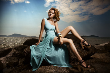 Portrait Of Fashion Woman In Blue Dress Outdoor