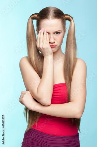 Upset Freckled girl in red dress