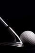 golf  club  with ball on black background