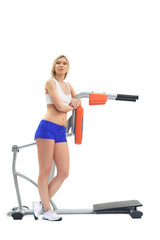 Athletic blonde with isodynamic exerciser