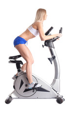 Athletic blonde training on bike exerciser