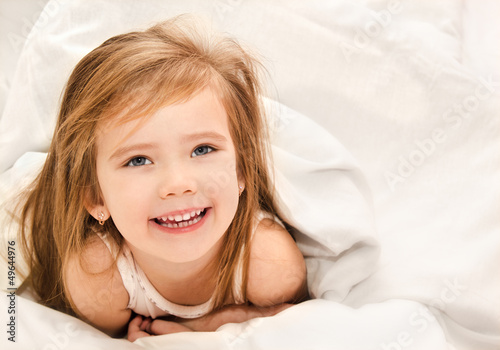 Adorable little girl awaked up