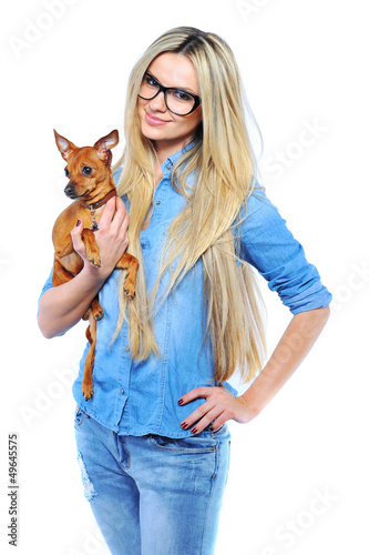 Beautiful smiling woman holding her little puppy isolated on whi