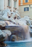 One of the two Tritons of the Trevi fountain, in Rome, Italy