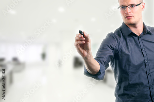 young man writing something with marker in the office