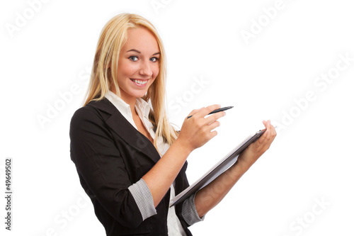 Young woman with checklist looking into camera