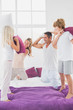 Family having fun with pillows