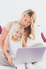 Mother and her daughter using a laptop