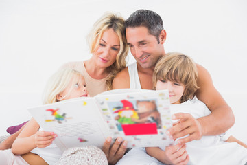 Happy family reading a story together