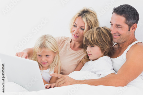 Family watching a laptop screen together