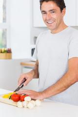 Happy man preparing vegetables