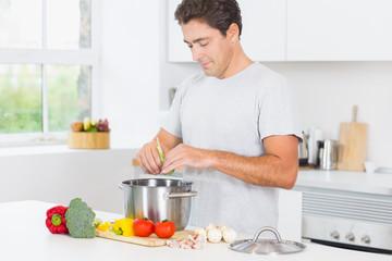 Happy man making dinner