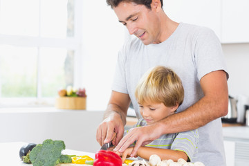 Father and son preparing vegetables together