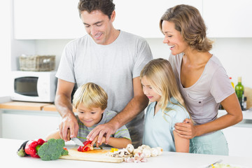 Family preparing vegetables together