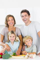 Smiling family preparing vegetables