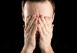 Portrait of stressed man covers face with hands