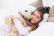 Little girl and her teddy bear