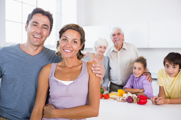 Mother and father standing by kitchen counter