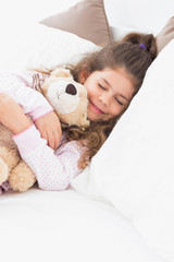 Little girl asleep with teddy