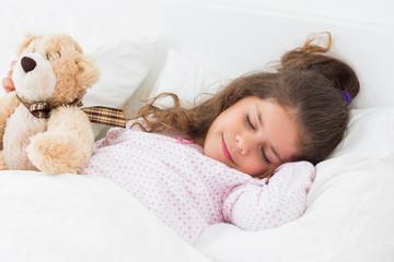 Cute girl asleep with teddy bear