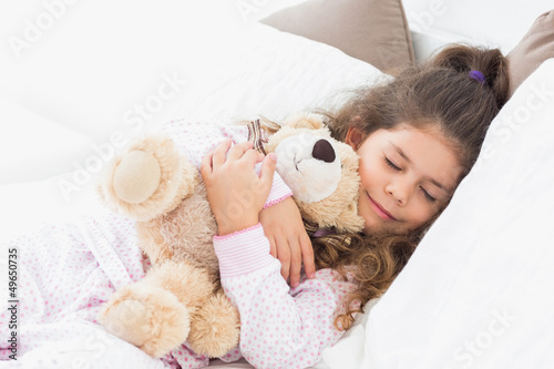Little girl asleep with her teddy bear