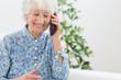 Elderly happy woman calling someone