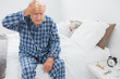 Elderly man suffering with head pain