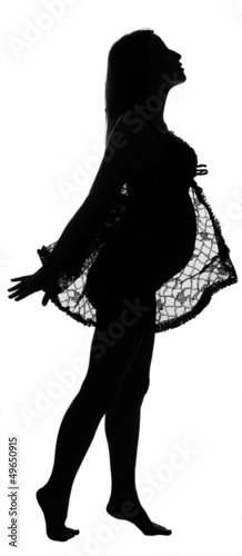 Black silhouette of pregnant woman in lacy tippet