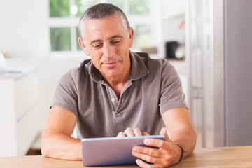 Happy man using tablet