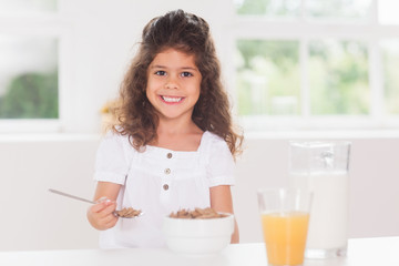 Little girl eating cereal