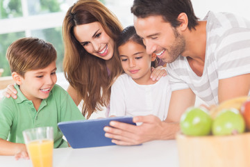 Family using a tablet pc