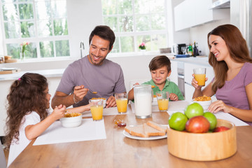 Family eating healthy breakfast