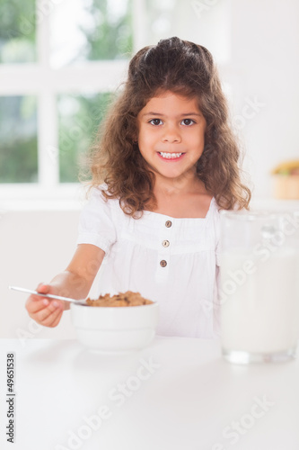 Little girl having cereal