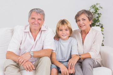 Portrait of a little boy and his grandparents