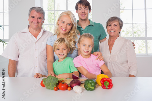 Family smiling with vegetables