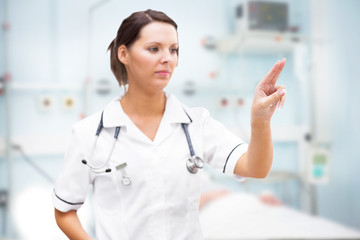 Nurse pointing at invisible screen