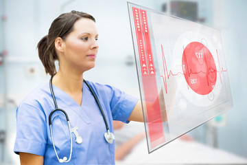 Nurse touching screen displaying red ECG line