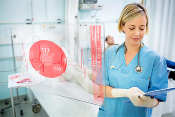 Nurse consulting tablet with screen displaying ECG in foreground