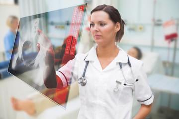 Nurse pressing on screen showing pelvic x-ray