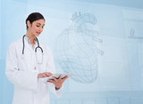 Woman doctor using a tablet pc in front of hearth sketch