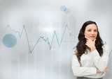 Businesswoman standing with a digital graph