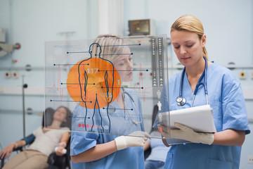 Nurses looking at a clipboard