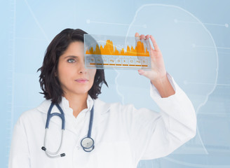Brunette doctor looking at a graph with new technology